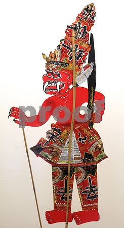 """""""...is Coming"""" (2011) by Siew Lian Lim and made of food wrappers, repurposed plastic file divider, aluminum soft drink can, bamboo and thread. Part of the 'Echoing Balance' display at the DeKalb Area Women's Center.<br /> <br /> This is Maharaja Wana, the Malaysian equivalent of Ravana from their version of The Ramayana - Cerita Mahraja Wana."""