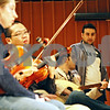 Rob Winner – rwinner@shawmedia.com<br /> <br /> Omar Almusfi (right), a graduate student and co-director of the Northern Illinois University Middle Eastern Music Ensemble, works with Wanees Zarour, who was playing the buzuq, during rehearsal on Tuesday, Nov. 15, 2011, at the School of Music in DeKalb.