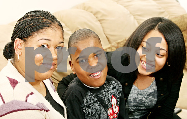 Rob Winner – rwinner@daily-chronicle.com<br /> <br /> The Griffin-Watford family which includes Danielle (from left to right), Shakur, 12, and Shikara, 18, at their home in DeKalb on Monday night. Shakur Watford was born 15 weeks early weighing 1 pound, 8 ounces, is now a sixth grade student at Clinton Rosette Middle School. Shakur and his family are the ambassadors for the March of Dimes' 2011 March for Babies.<br /> <br /> ***The mother, Danielle, was hoping to have the 'Griffin-Watford family' instead of having Danielle Griffin and Shakur and Shikara Watford. - Rob**