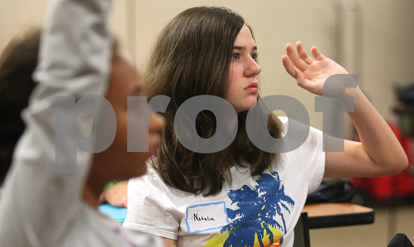 Kyle Bursaw – kbursaw@daily-chronicle.com<br /> <br /> Natalie Thirtle, 13, raises her hand to answer a question about babysitting during a class at Kishwaukee Hospital on Wednesday, July 20, 2011.