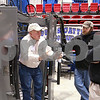 Kyle Bursaw – kbursaw@daily-chronicle.com<br /> <br /> Dennis Mottle of Dubas Cattle Co. explains his company's equipment to Bret (center) and Gene Shaumway (right) during the Farm Show at the Convocation center on Wednesday, Jan. 12, 2011.