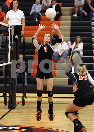Wendy Kemp - For The Daily Chronicle<br /> DeKalb's McKenna Teboda sets the ball for Courtney Bemis (13) during Saturday's game against Zion Benton.<br /> DeKalb 9/10/11