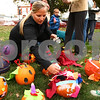 Kyle Bursaw – kbursaw@shawmedia.com<br /> <br /> Kyla Hueber, a teacher at Southeast Elementary, places identification numbers on the pumpkin entries from her third grade class for the 2011 Sycamore Pumpkin Festival on the DeKalb County Courthouse lawn on Wednesday, Oct. 26, 2011.