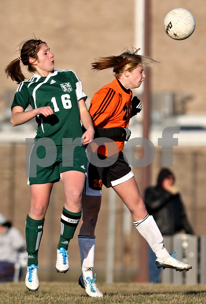 Rob Winner – rwinner@daily-chronicle.com<br /> <br /> Boylan's Moriah Schwarz (16) and DeKalb's Abby Hickey (20) go up for a ball during the second half in DeKalb, Ill., on Monday, March 28, 2011. Boylan defeated DeKalb, 3-0.