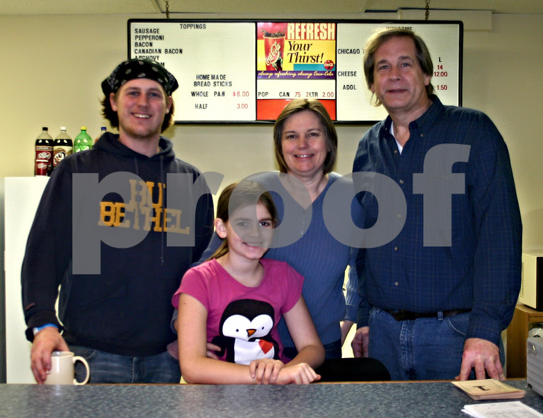 The the help of three of their seven children, the Wellendorfs have been operating their new restaurant, Village Pizza, in Malta since Dec. 1. Pictured from left are Christopher, Hannah, Carol and David Wellendorf.<br /> <br /> By Nicole Weskerna - nweskerna@shawmedia.com