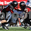 Rob Winner – rwinner@shawmedia.com<br /> <br /> Northern Illinois linebacker Jordan Delegal (29) and defensive lineman Nabal Jefferson (99) stop Western Michigan quarterback Alex Carder (center) for no gain during the second quarter in DeKalb, Ill., on Saturday, Oct. 15, 2011. Northern Illinois defeated Western Michigan, 51-22.