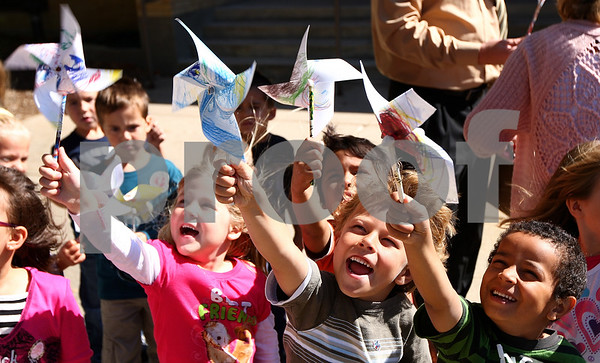 Kyle Bursaw – kbursaw@shawmedia.com<br /> <br /> Kindergartners (from left) Brylee Honiotes, Jonathan Locascio and Lucas Jacob hold up their pinwheels as a breeze comes through before planting them in front of West Elementary for a 'Pinwheels for Peace' project in Sycamore, Ill. on Wednesday, Sept. 21, 2011.