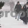 Kyle Bursaw – kbursaw@daily-chronicle.com<br /> <br /> A few people walk through the windy and snowy conditions on Tuesday, Feb. 1, 2011.