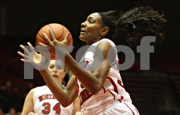 Rob Winner – rwinner@shawmedia.com<br /> <br /> Northern Illinois forward Shaakira Haywood controls a pass before going to the basket for two during the first half in DeKalb, Ill., on Wednesday, December 14, 2011.