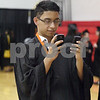 Wendy Kemp - For The Daily Chronicle<br /> <br /> Graduate Juan Tellez takes two pictures at once before the DeKalb High School graduation ceremony at the Convocation Center at Northern Illinois University on Saturday.