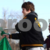 Kyle Bursaw – kbursaw@shawmedia.com<br /> <br /> Dustin King, accompanied by his sister Kaitlyn and brother Daniel (not pictured), hands off a gift bag to a person at their front door. The three Kings, accompanied by their parents, delivered gifts to four families while volunteering with Goodfellows of DeKalb-Sycamore.