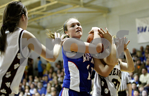 Rob Winner – rwinner@daily-chronicle.com<br /> <br /> Hinckley-Big Rock's Katie Hollis (12) and St. Benedict's Amanda Nota (20) struggle for possession under the Lady Royals' basket during the second quarter of the IHSA Class 1A H-BR Sectional final in Hinckley, Ill., on Thursday February 17, 2011. Hinckley-Big Rock went on to defeat St. Benedict, 63-25.