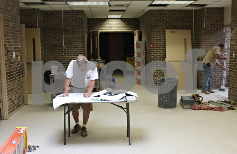 Rob Winner – rwinner@daily-chronicle.com<br /> <br /> Bob Petta, of Morse Electric, looks over temperature control plans while working at the new Huntley Middle School in DeKalb on Friday afternoon.