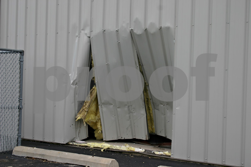 A hole can be seen in an unoccupied building in the 600 block of Enterprise Avenue in DeKalb after a woman drove her Chevrolet Suburban through it Friday morning. The woman hit the gas pedal instead of the brake, said DeKalb Police Cpl. Scott Farrell, and will be charged with no valid driver's license, no insurance and failure to report an accident.<br /> <br /> Caitlin Mullen - cmullen@daily-chronicle.com