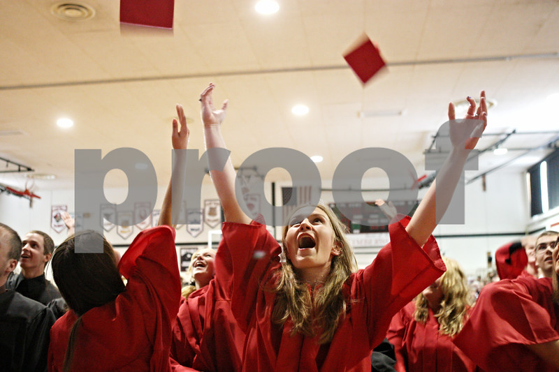 Rob Winner – rwinner@daily-chronicle.com<br /> <br /> Alex Cultra looks up after tossing her cap into the air after the Indian Creek High School commencement on Sunday, May 15, 2011, in Shabbona, Ill.