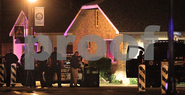 Kyle Bursaw – kbursaw@daily-chronicle.com<br /> <br /> Law enforcement, many with guns drawn, surround a house during a standoff at the northeast corner of Railroad Ave and South Somonauk Road in Cortland, Ill. on Thursday, July 21, 2011.