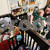 Kyle Bursaw – kbursaw@daily-chronicle.com<br /> <br /> Megan Davis puts her son Finn Davis into his crib after hooking up his feeding tube in their home in Sycamore, Ill. on Tuesday, Feb. 15, 2011. The empty crib on the left is for Finn's identical twin brother Evan. Evan was born with Hypoplastic Left Heart Syndrome and is currently in a hospital near Milwaukee.