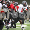 Kyle Bursaw – kbursaw@daily-chronicle.com<br /> <br /> Jamal Womble (5) runs past defenders during practice at Huskie Stadium on Tuesday, March 22, 2011.
