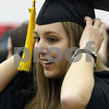 Wendy Kemp - For The Daily Chronicle<br /> Cassie Bertsch straightens her hat before Sunday's graduation ceremony at Northern Illinois University.<br /> DeKalb 12/11/11
