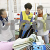 Rob Winner – rwinner@shawmedia.com<br /> <br /> (From left to right) Rita Wiesbrook, Linda Holley and Donna Leonard organize needlework entries within the Home Arts Building on the Sandwich Fairgrounds on Monday, Sept. 5, 2011. The 124th annual Sandwich Fair begins this Wednesday and runs until Sunday.