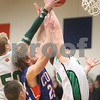 Kyle Bursaw – kbursaw@daily-chronicle.com<br /> <br /> Genoa-Kingston's Robert Thurlby battles with Rock Fall's players Steven Armoska (left) and Shay Brown (right) during the first quarter of the game. The Genoa-Kingston Cogs defeated the Rock Falls Rockets 62-49 in Genoa, Ill. on Tuesday, March 1, 2011.