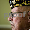 Kyle Bursaw – kbursaw@shawmedia.com<br /> <br /> Joe Bussone looks out a window in the DeKalb County Courthouse to the people giving the twenty-one gun salute to cue them to fire. The Veterans Day ceremony on Friday, Nov. 11, 2011 at the courthouse was moved inside because of weather.