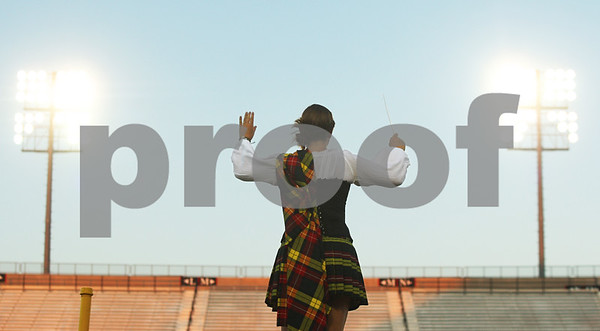 Kyle Bursaw – kbursaw@daily-chronicle.com<br /> <br /> Drum Major Kali Senger, 20, directs the Kilties from Racine, Wis. as they perform at Huskie Stadium during a drum and bugle competition on Saturday, July 30, 2011.