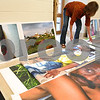 "Kyle Bursaw – kbursaw@daily-chronicle.com<br /> <br /> Lynn Hill lays out prints from the project ""Visual Voices"" in preparation for hanging them around Bethlehem Evangelical Lutheran Church in DeKalb, Ill. on Thursday, June 23, 2011. Hill brought cameras with her on a trip to Bhopal, India that she gave to children to take photos of their lives that make up the content of the project."