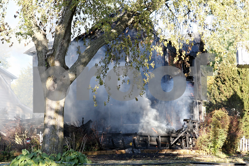 Rob Winner – rwinner@shawmedia.com<br /> <br /> Smoke continues to billow from a house after a fire in Genoa on Wednesday afternoon.