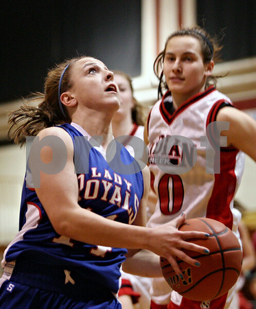 Rob Winner – rwinner@daily-chronicle.com<br /> <br /> After a steal, Hinckley-Big Rock's Kaitlin Phillips (left) moves past Indian Creek defender Anna Stiker on her way to the basket for two during the first quarter in Shabbona, Ill. on Monday, January 10, 2011.