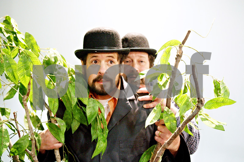 """Rob Winner – rwinner@daily-chronicle.com<br /> <br /> Gavin Wilson (left) and Chris Porterfield rehearse a scene from """"Waiting for Godot"""" at Northern Illinois University in Dekalb on Thursday evening."""