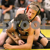Kyle Bursaw – kbursaw@daily-chronicle.com<br /> <br /> Kaneland's Stephen Gust wraps up Hampshire's Alex Feltz at Sycamore High School on Saturday, Feb. 5, 2011. Gust defeated Feltz to take first place at 103 pounds in the regional tournament.