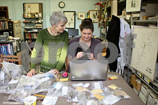 Rob Winner – rwinner@shawmedia.com<br /> <br /> Professor Winifred Creamer (left) helps freshman Lindsey Komes as she catalogs artifacts that were unearthed from an archaeological dig in New Mexico on Thursday afternoon at Northern Illinois University. Komes, a Research Rookie, has teamed up with Creamer, a faculty mentor, to learn what research looks in her field of study.