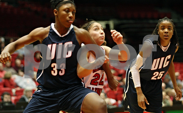Rob Winner – rwinner@shawmedia.com<br /> <br /> University of Illinois-Chicago forward Cree Nix (33) and Northern Illinois freshman guard Amanda Corral (22) position themselves for a potential rebound after a shooting foul during their game on Wednesday, Dec. 14, 2011, in DeKalb, Ill.