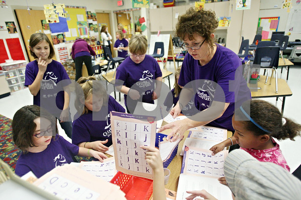 Rob Winner – rwinner@shawmedia.com<br /> <br /> Second grade teacher and Girls on the Run coach Jackie Cleven works with a group of students while conducting a community service project at South Prairie Elementary School in Sycamore on Tuesday. Girls on the Run is a national program designed to help boost self esteem and promote physical activity for girls in third through fifth grades.