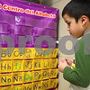 Kyle Bursaw – kbursaw@shawmedia.com<br /> <br /> Josue Lopez-Contreras, a first-grader in a bilingual classroom at Cortland Elementary, files flash cards under the appropriate letter of the alphabet during a work time in Lisette Jacobson's class on Thursday, Nov. 17, 2011.