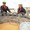 Kyle Bursaw – kbursaw@shawmedia.com<br /> <br /> Mark Baker (left), of Stateline Farm Rescue, gives some tips on rescuing people trapped in grain bins during a training session at a farm in Sycamore, Ill. on Saturday, Sept. 24, 2011.
