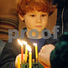 Wendy Kemp - For The Daily Chronicle<br /> Cameron Kruskol, 6, watches the candle lighting at Congregation Beth Shalom on Sunday in DeKalb.<br /> DeKalb 12/18/11