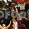 Rob Winner – rwinner@shawmedia.com<br /> <br /> Northern Illinois' Abdel Nader (23) has his shot blocked by Southern Illinois forward Dantiel Daniels during the second half in DeKalb, Ill., on Saturday, Dec. 17, 2011. SIU defeated NIU, 62-49.