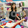 Rob Winner – rwinner@daily-chronicle.com<br /> <br /> 10-year-old Sydney Bartlett (right), of Cortland, tosses a pencil bag into a shopping cart while buying school supplies with her mother Erika Bartlett at Target in DeKalb on Monday afternoon.