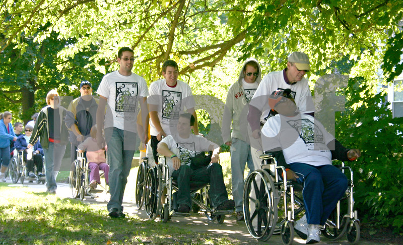 Participants in the 11th annual Wheel-a-thon supported the local RAMP organization by walking and rolling through DeKalb Saturday.<br /> <br /> By NICOLE WESKERNA - nweskerna@shawmedia.com