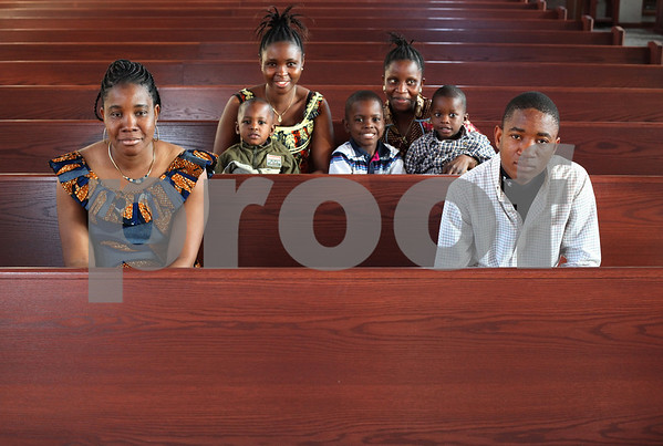 Kyle Bursaw – kbursaw@shawmedia.com<br /> <br /> Kona Soko (front left) and her children Melah Gbeandeh (back left) and Yei Gbeandeh (back right) and Nathan Saye (front right) and her grandchildren (middle, from left) Daniel Kollie, Emmanuel Saye and Abraham James are all from Liberia and have come to America to escape religious persecution in their home country. Evangelical Church of St. John (where the family is pictured) has helped the family find clothing, food and shelter in Sycamore.<br /> <br /> Monday, Nov. 21, 2011.