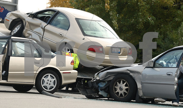 Kyle Bursaw – kbursaw@shawmedia.com<br /> <br /> A towing company employee secures one vehicle from a three-car collision at Peace Road and Hathaway Drive as the other two wait to be towed on Friday, Oct. 28, 2011.