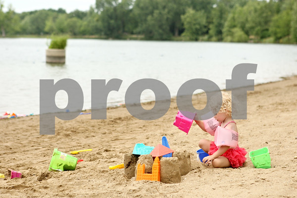 Rob Winner – rwinner@daily-chronicle.com<br /> <br /> Hailey Nieder, 2, of Ottawa, plays in the sand at the beach of Sycamore RV Resort on Monday afternoon.