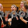 Rob Winner – rwinner@shawmedia.com<br /> <br /> Members of the DeKalb volleyball team including Baleigh Euhus (2), Kendall Baum (5), Courtney Bemis (13) and Madison Lord (1) celebrate a kill by Bemis late in the second game against South Elgin during the Class 4A Elgin Regional championship on Thursday. DeKalb defeated South Elgin, 25-7 and 26-24.