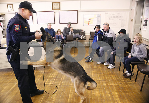 Kyle Bursaw – kbursaw@daily-chronicle.com<br /> <br /> Deputy Bill Gatske interacts with canine officer Gino while fielding questions from visitors at an open house at the police department in the Village of Maple Park, Ill. on Saturday, Jan. 22, 2011.