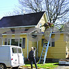 Sycamore firefighters work to extinguish a fire late Friday morning that started in the wall cavity and roof line of a home in the 400 block of Stark Avenue in Sycamore. Sycamore Fire Chief Mark Kessler said the homeowner inadvertently shorted an electrical wire, causing the small fire. Homeowners Alex and Leticia Nunez said they smelled smoke and saw sparks while working on the roof. Firefighters worked to strip away siding and cut holes in the roof to ensure the fire hadn't spread elsewhere.<br /> <br /> Caitlin Mullen - cmullen@shawmedia.com
