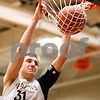 Kyle Bursaw – kbursaw@shawmedia.com<br /> <br /> Sycamore forward Tom Paulson slams one in for two during third quarter of their match in the Chuck Dayton Holiday Tournament at DeKalb High School on Friday, Dec. 23, 2011. Sterling defeated Sycamore 61-41.