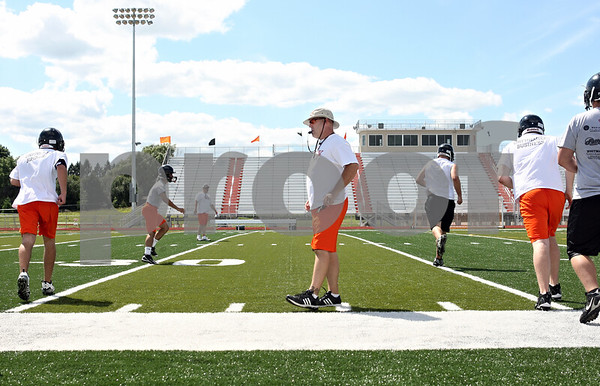 Rob Winner – rwinner@daily-chronicle.com<br /> <br /> Coach Marty Sanders blows his whistle during warmups at practice on Wednesday afternoon at the new DeKalb High School facilities.