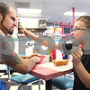 Kyle Bursaw – kbursaw@daily-chronicle.com<br /> <br /> Joe Riccardi reacts to Connor Riccardi, 5, putting a pickle in his face while eating lunch at the restaurant owned by Joe's parents, Riccardi's Red Hots & Soda Fountain, in Sycamore, Ill. on Friday, May 13, 2011.